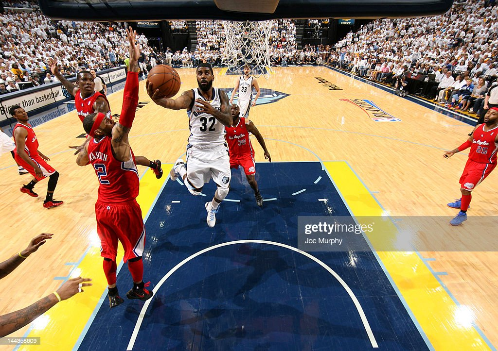 O.J. Mayo #32 of the Memphis Grizzlies shoots a layup against Kenyon Martin #2 of the Los Angeles Clippers in Game Seven of the Western Conference Quarterfinals during the 2012 NBA Playoffs on May 13, 2012 at FedExForum in Memphis, Tennessee.