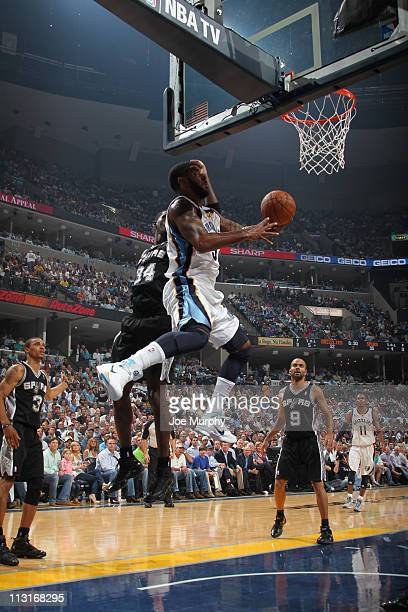 J Mayo of the Memphis Grizzlies shoots against Antonio McDyess of the San Antonio Spurs in Game Four of the Western Conference Quarterfinals in the...