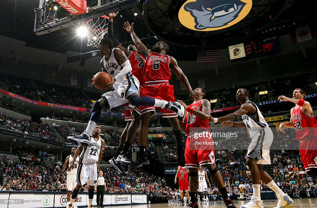 J Mayo of the Memphis Grizzlies shoots against Hakim Warrick and Flip Murray of the Chicago Bulls on March 16 2010 at FedExForum in Memphis Tennessee...
