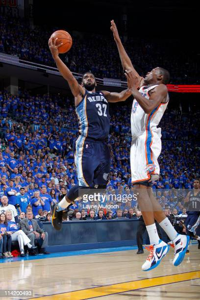 J Mayo of the Memphis Grizzlies shoots against Kevin Durant of the Oklahoma City Thunder in Game Seven of the Western Conference Semifinals during...