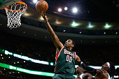 J Mayo of the Milwaukee Bucks attempts a layup against the Boston Celtics in the fourth quarter during the game at TD Garden on December 3 2013 in...