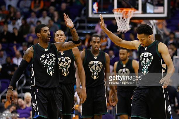 J Mayo of the Milwaukee Bucks highfives Rashad Vaughn after scoring against the Phoenix Suns during the second half of the NBA game at Talking Stick...