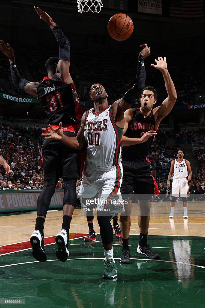 OJ Mayo #00 of the Milwaukee Bucks shoots against (L-R) <a gi-track='captionPersonalityLinkClicked' href=/galleries/search?phrase=Terrence+Ross&family=editorial&specificpeople=6781663 ng-click='$event.stopPropagation()'>Terrence Ross</a> #31 and <a gi-track='captionPersonalityLinkClicked' href=/galleries/search?phrase=Landry+Fields&family=editorial&specificpeople=4184645 ng-click='$event.stopPropagation()'>Landry Fields</a> #2 of the Toronto Raptors on November 2, 2013 at the BMO Harris Bradley Center in Milwaukee, Wisconsin.
