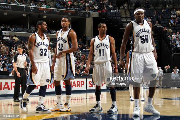 J Mayo Rudy Gay Mike Conley and Zach Randolph of the Memphis Grizzlies stand on the court during the game against the Dallas Mavericks at the...