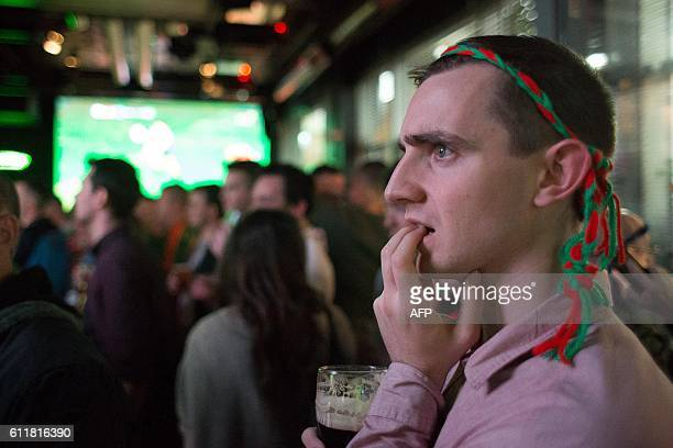 A Mayo supporter reacts as he watches GAA AllIreland Gaelic Football Final replay match between Dublin and Mayo in a city centre pub in Dublin...