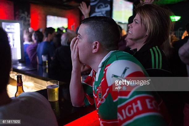 A Mayo supporter reacts as his side goes down to defeat as he watches the GAA AllIreland Gaelic Football Final replay match between Dublin and Mayo...