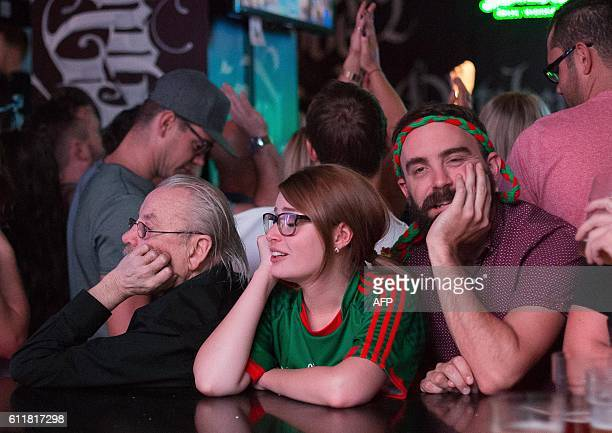 Mayo supporters react to their defeat at the final whistle after they watch the GAA AllIreland Gaelic Football Final replay match between Dublin and...
