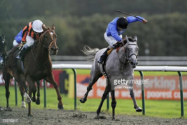 Mayonga riden by Seb Sanders chases Emily Bronte riden by Eddie Ahern as Mayonga goes on to win The EBF Fleur De Fillies' Stakes run at Lingfield...