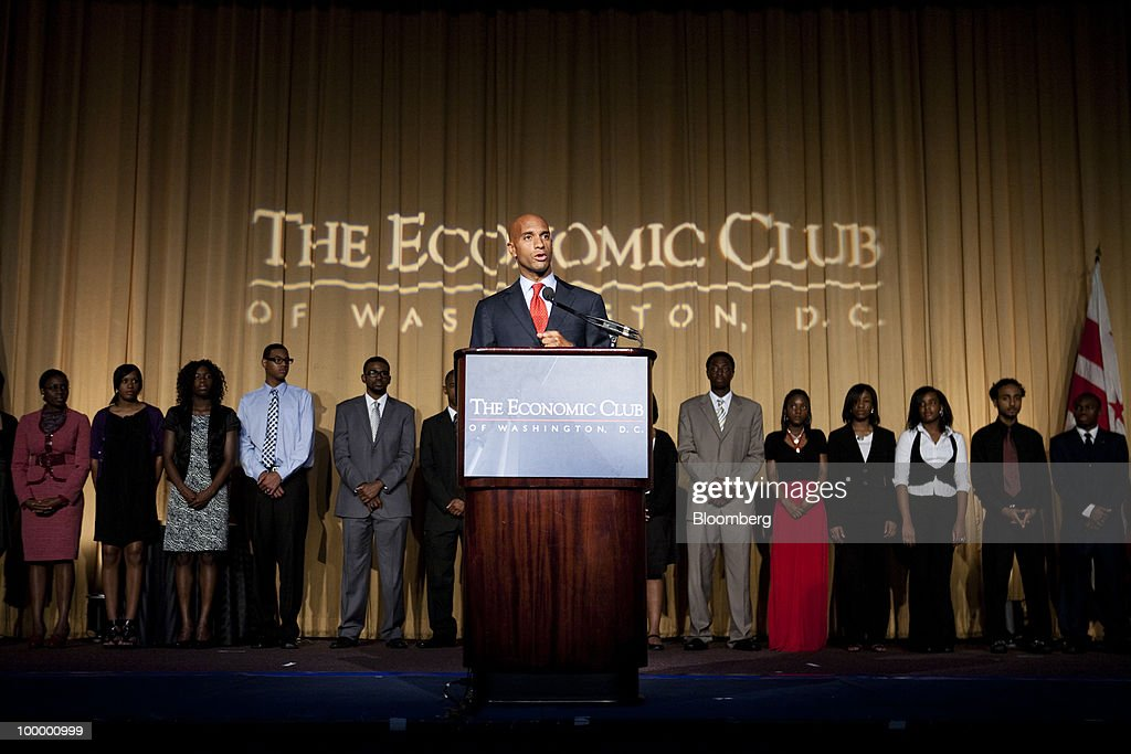 Mayor Adrian M. Fenty of Washington, D.C., presents scholarships at a meeting of the Economic Club of Washington, D.C., in Washington, D.C., U.S., on Wednesday, May 19, 2010. Muhtar Kent, chairman and chief executive officer of Coca-Cola Co., helped present scholarships of $5,000 each to 38 local students. Photographer: Brendan Hoffman/Bloomberg via Getty Images