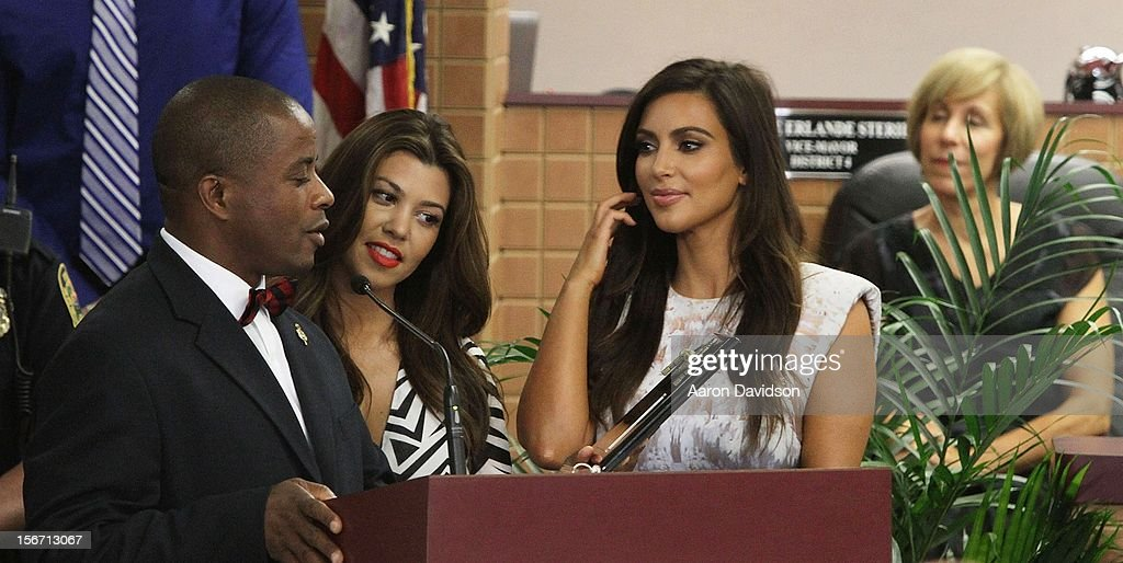 Mayor Andre Pierre presents Kourtney and <a gi-track='captionPersonalityLinkClicked' href=/galleries/search?phrase=Kim+Kardashian&family=editorial&specificpeople=753387 ng-click='$event.stopPropagation()'>Kim Kardashian</a> with keys to the City Of North Miami on November 19, 2012 in North Miami, Florida.