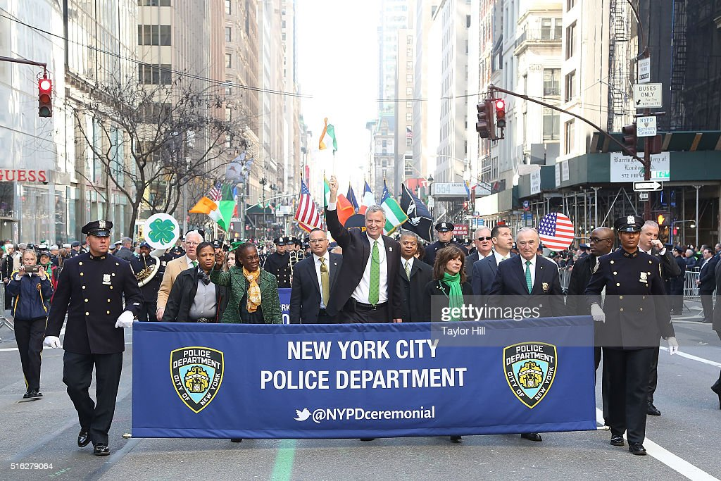 Mayor Bill de Blasio, Chirlane McCray, Rikki Klieman, and Bill Bratton march up 5th Avenue during the 2016 St. Patrick's Day Parade on March 17, 2016 in New York City.