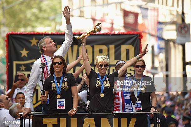 Mayor Bill de Blasio Soccer players Carli Lloyd and Megan Rapinoe Chirlane McCray and US Coach Jill Ellis aboard a float in the New York City Ticker...