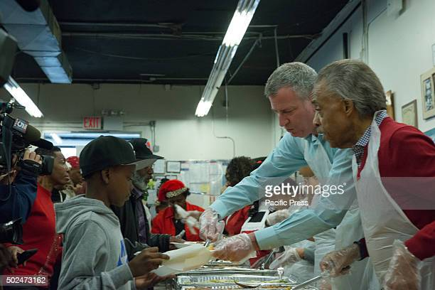 Mayor de Blasio and Reverend Sharpton serve food at the NAN holiday meal New York City Mayor Bill de Blasio and his daughter Chiara joined Reverend...