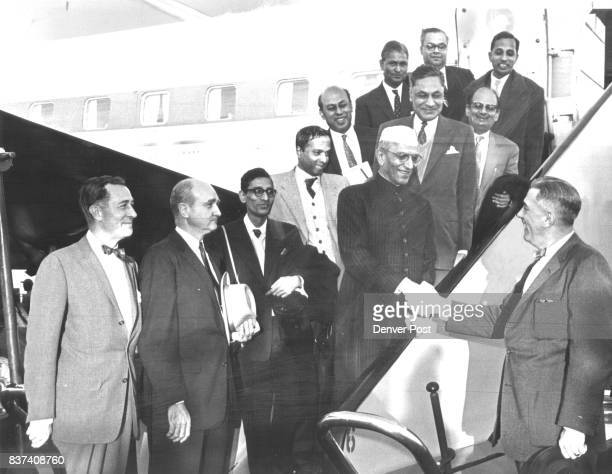 Mayor Dick Batterton shakes hands with India's finance minister Morarji Desai as he welcomes Desai and his party of India economic officials to...