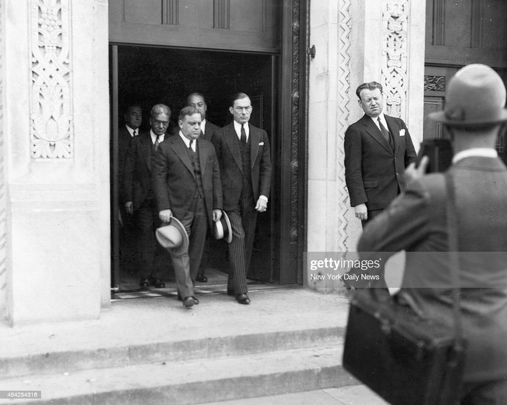 Mayor Fiorello LaGuardia and Jimmy Walker lead ninety honorary pallbearers out of Temple Emanu-El. NOTABLES of stage, legal and political worlds attend funeral rites for attorney Nathan Burkan. Gene Buck made brief eulogy at Temple Emanu-El services which fifteen hundred persons attended.