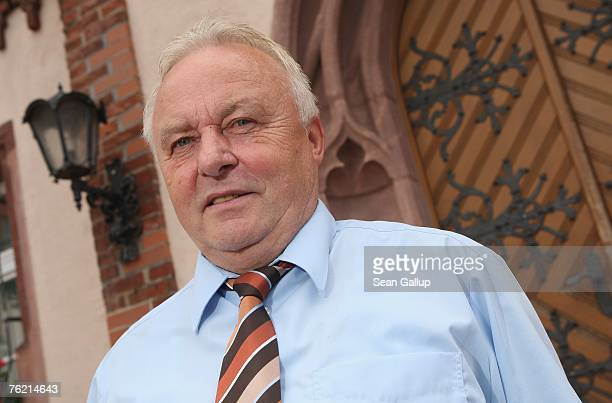 Mayor Gotthard Deuse poses for a picture outside City Hall August 22 2007 in Muegeln Germany A group of approximately 50 youths some of whom yelled...
