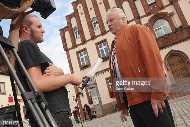 Mayor Gotthard Deuse speaks to the media outside City Hall August 22 2007 in Muegeln Germany A group of approximately 50 youths some of whom yelled...