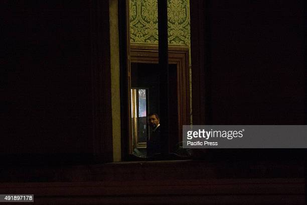 Mayor Ignazio Marino seen at the window of his office during a protest for his resignation