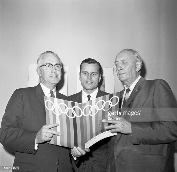Mayor James HJ Tate of Philadelphia and fourtime Olympic oarsman John B Kelly Jr brother of Princess Grace of Monaco show prospectus on their bid to...