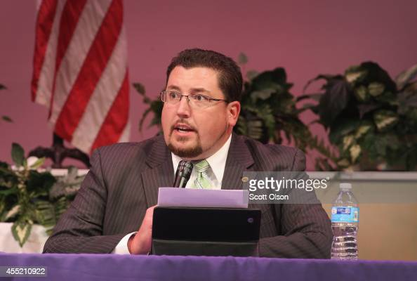 Mayor James Knowles presides over the city council meeting on September 9 2014 in Ferguson Missouri The meeting was held at Greater Grace Church to...