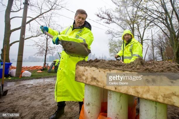 TORONTO ON MAY 5 Mayor John Tory and Toronto Island park supervisor Warren Hoselton fill sandbags on Wards Island Toronto Mayor John Tory visited the...