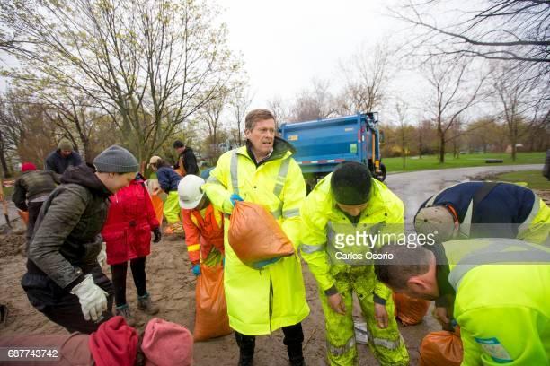 TORONTO ON MAY 5 Mayor John Tory filled some sandbags at Wards Island Toronto Mayor John Tory visited the Wards Island to see the flooding efforts...