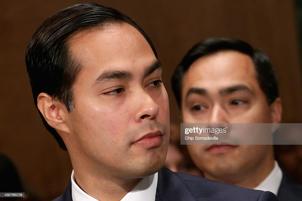 Mayor Julian Castro (L) testifies during his confirmation hearing before the Senate Banking, Housing and Urban Affairs Committee with his twin brother, Rep. Joaquin Castro (D-TX), in the background June 17, 2014 in Washington, DC. The current mayor of San Antonio, Texas, Castro has not faced serious opposition in the Senate.