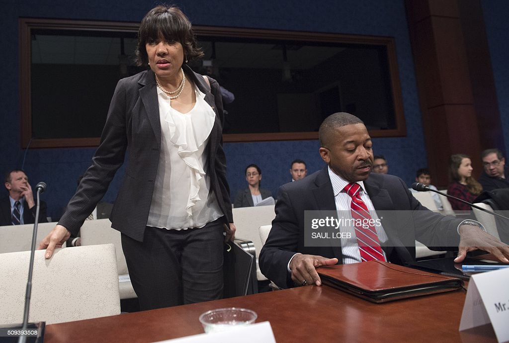 Mayor Karen Weaver (L) of Flint, Michigan, and Bilal Kareem Tawwab, Superintendent of Flint, Michigan School District, arrive to testify about the lead levels found in Flint's water supply during a House Democratic Steering and Policy Committee hearing on Capitol Hill in Washington, DC, February 10, 2016. / AFP / SAUL LOEB