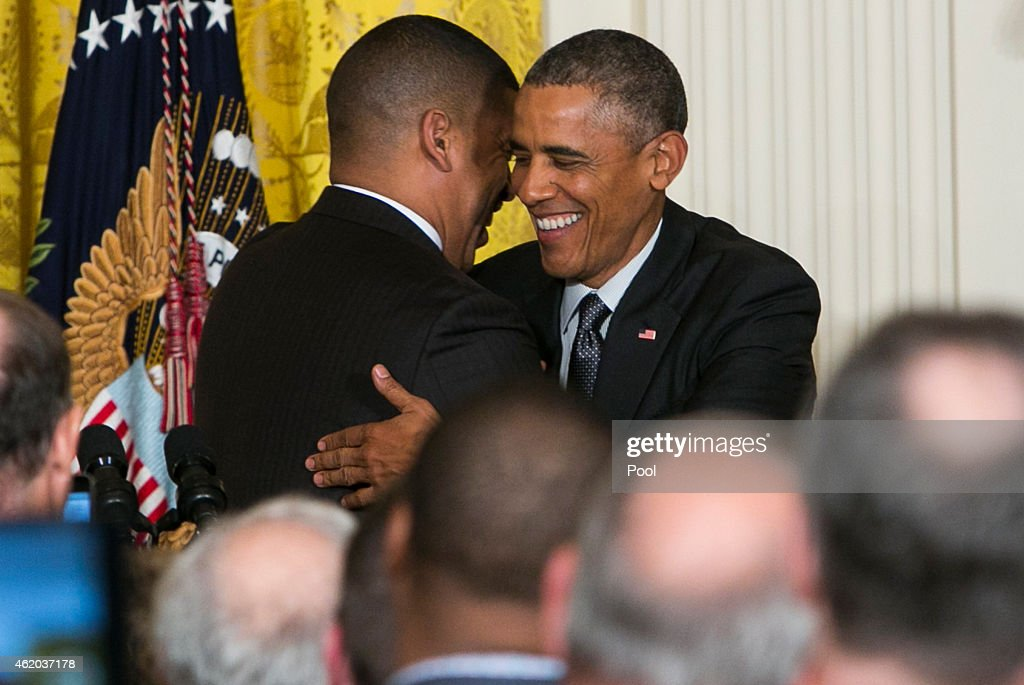 Mayor Kevin Johnson of Sacramento California introduces US President Barack Obama during an event for the US Conference of Mayors in the East Room of...