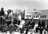 Mayor Kurt Schmoke giving a speech at an American Red Cross event 1980 Sign says Hope on Mt Hope