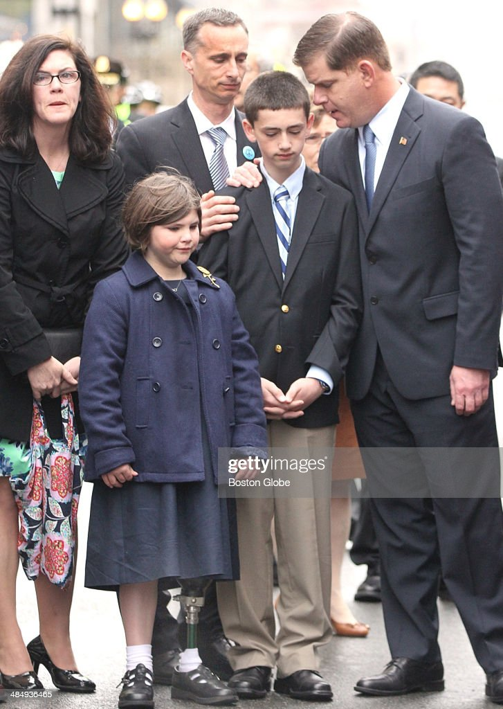 Mayor Martin J. Walsh , right, expressed condolences to the family of bombing victim Martin Richard, including his parents, Denise and Bill, sister, Jane, and brother, Henry, during a wreath laying ceremony commemorating the one year anniversary of the Boston Marathon bombing in Boston, April 15, 2014. One year ago, April 15, 2013, two homemade explosive devices killed three and injured more than 250 near the finish line of the race.