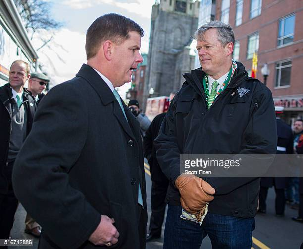 Mayor Martin Walsh of Boston talks to Governor Charlie Baker of Massachusetts before the annual South Boston St Patrick's Parade passes on March 20...