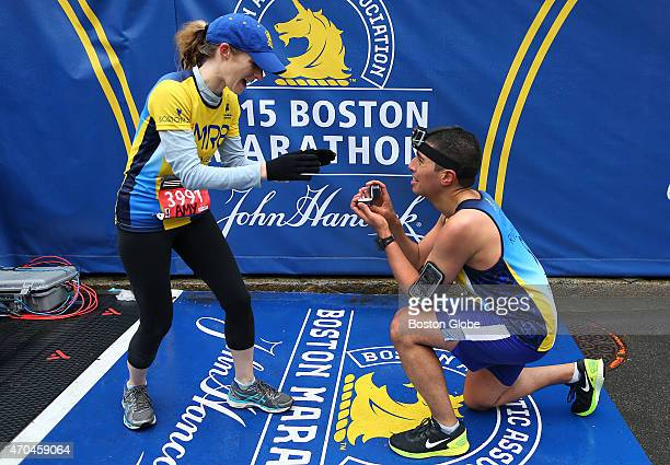 Mayor Marty Walsh's Chief of Staff Daniel Koh proposes to his fiancee Amy Sennett on the finish line after they both finished the Boston Marathon...