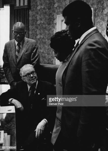 Mayor McNichols Seated Talks With Visitors With mayor from left are W Gene Howell Miss Meola Upshaw and Lawrence Lewis all officials of the NAACP...
