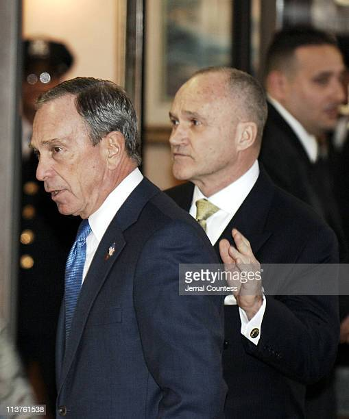 Mayor Michael Bloomberg and Raymond W Kelly at the wake for slain 28yearold NYPD Officer Daniel Enchautegui on December 13 2005