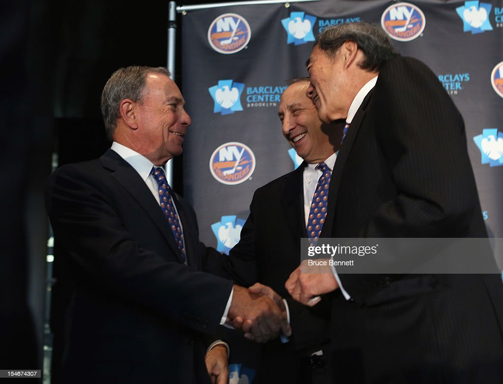 Mayor Michael Bloomberg, owner Bruce Ratner of the Brooklyn Nets and New York Islanders owner Charles Wang announce the team's move to Brooklyn in 2015 at a press conference at the Barclays Center on October 24, 2012 in the Brooklyn borough of New York City.
