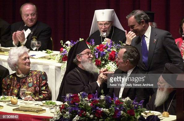 Mayor Michael Bloomberg shakes hands with Archbishop Demetrios head of the Greek Orthodox Archdiocese of America as former First Lady Barbara Bush...