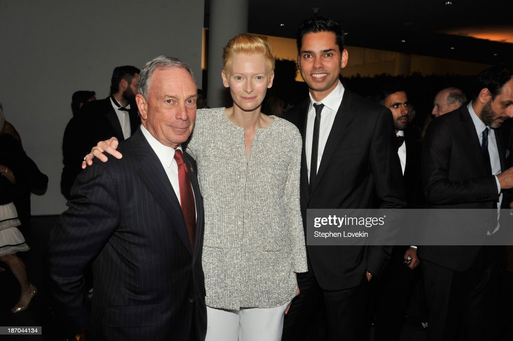 Mayor Michael R. Bloomberg, actress <a gi-track='captionPersonalityLinkClicked' href=/galleries/search?phrase=Tilda+Swinton&family=editorial&specificpeople=202991 ng-click='$event.stopPropagation()'>Tilda Swinton</a> and <a gi-track='captionPersonalityLinkClicked' href=/galleries/search?phrase=Rajendra+Roy&family=editorial&specificpeople=2280257 ng-click='$event.stopPropagation()'>Rajendra Roy</a> attend The Museum of Modern Art Film Benefit: A Tribute to <a gi-track='captionPersonalityLinkClicked' href=/galleries/search?phrase=Tilda+Swinton&family=editorial&specificpeople=202991 ng-click='$event.stopPropagation()'>Tilda Swinton</a> reception at Museum of Modern Art on November 5, 2013 in New York City.