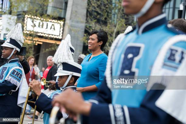 Mayor Muriel Bowser appears with the Eastern High School marching band during the opening ceremony of the Wharf complex along Maine Avenue SW on...