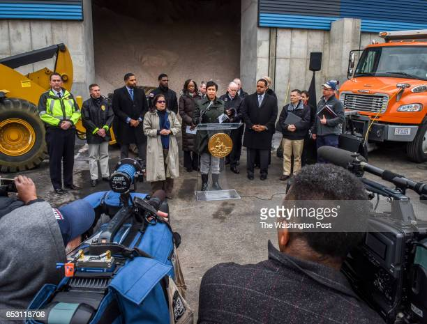 Mayor Muriel Bowser center and Administration officials hold a press conference at the South Capitol Street Salt Storage Facility to give an update...