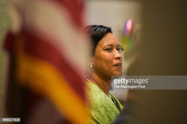Mayor Muriel Bowser listens to the speaker's introduction before going on stage during the 31st Annual Salute to District of Columbia Centenarians on...