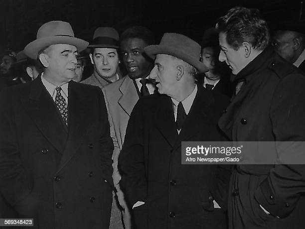 Mayor O'Dwyer Milton Berle Jackie Robinson Jimmy Durante and Danny Kaye outside the church at the funeral of Mr Bojangles Richmond Virginia December...