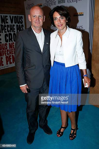 Mayor of 4th district of Paris Christophe Girard and Minister of Health Marisol Touraine attend the 'Breves de Comptoir' movie premiere at Theatre du...