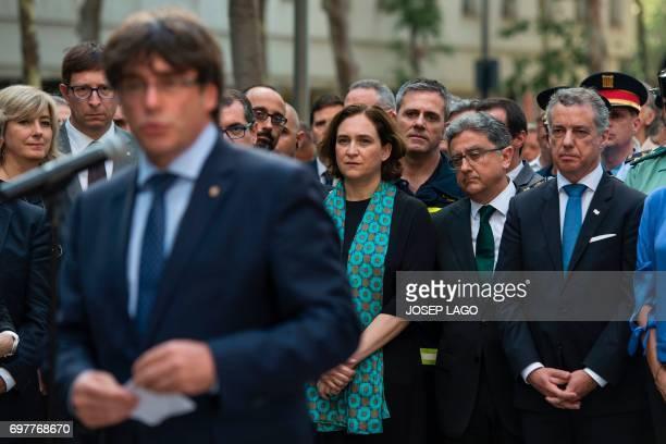 Mayor of Barcelona Ada Colau and President of the Basque regional government Inigo Urkullu listen to President of the Catalan regional government...