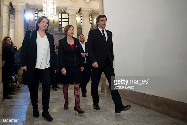 Mayor of Barcelona Ada Colau Catalan parliament president Carme Forcadell and President of the Catalan Government Carles Puigdemont arrive for a...