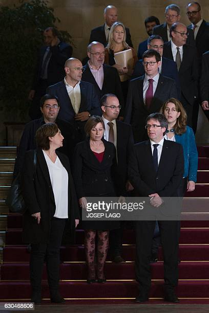 Mayor of Barcelona Ada Colau Catalan parliament president Carme Forcadell President of the Catalan Government Carles Puigdemont and Deputies pose...