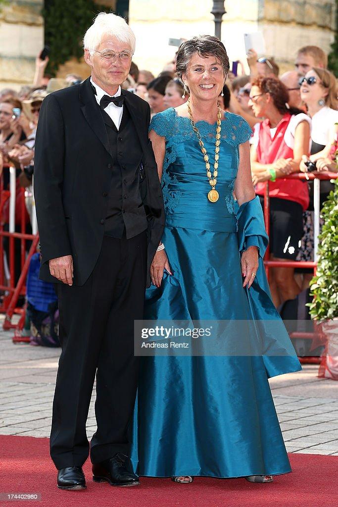 Mayor of Bayreuth Brigitte Merk-Erbe (R) amd her husband Thomas Erbe attend Bayreuth Festival Opening 2013 on July 25, 2013 in Bayreuth, Germany.