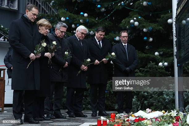 Mayor of Berlin Michael Muller German Chancellor Angela Merkel German Interior Minister Thomas de Maiziere and Interior Senator Andreas Geisel lay...