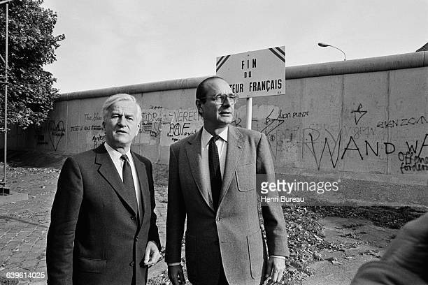 Mayor of Berlin Richard Von Weizsacker and Mayor of Paris Jacques Chirac standing in front of the Berlin Wall the French sector