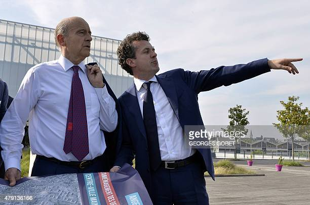 Mayor of Bordeaux Alain Juppe speaks to the Mayor of Angers Christophe Bechu about future renovation work on the terrace of the building 'le Quai' in...